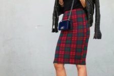 With black shirt, black leather jacket, crossbody mini bag and white pumps