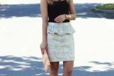 With black sleeveless top, printed clutch and beige pumps