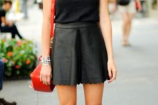 With black top and red bag
