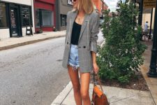 With black top, checked blazer, brown bag and lace up flats