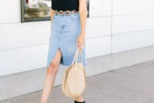 With black top, tote bag and black mules