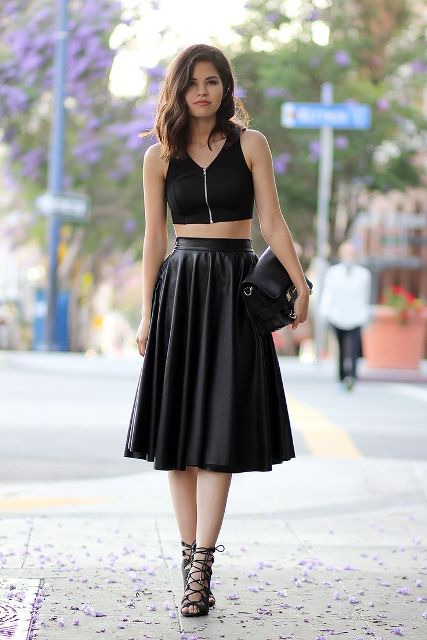 With black zipper top, leather clutch and lace up high heels