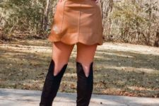 With blouse and high boots
