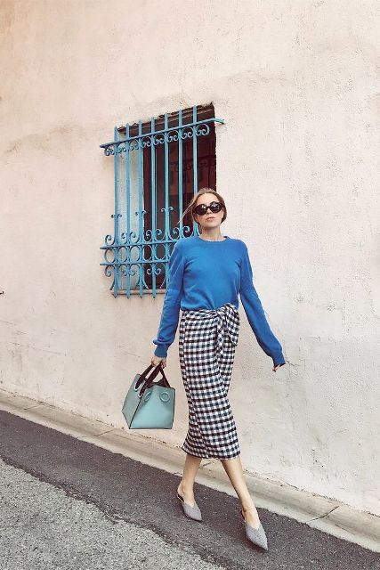 With blue shirt, light blue bag and gray mules