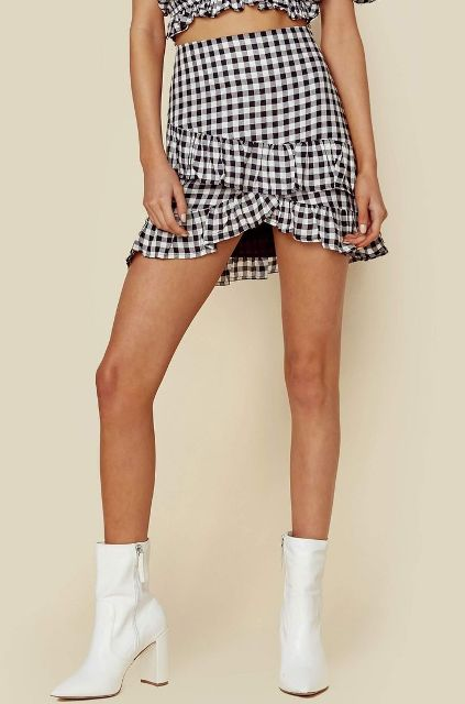 With checked cropped top and white ankle boots