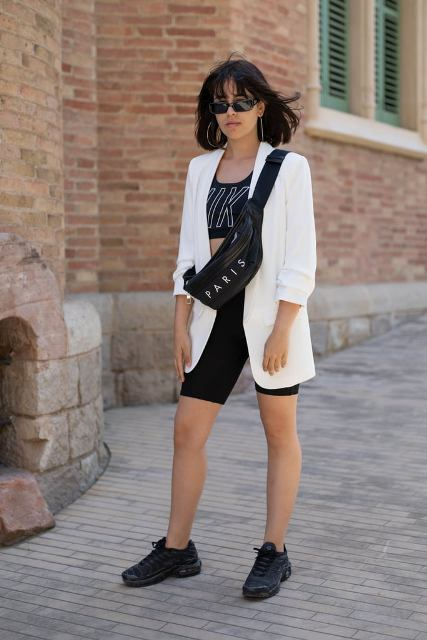 With crop top, white long blazer, bag and black sneakers