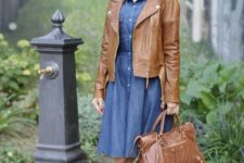 With denim knee-length dress, brown leather jacket and brown leather bag