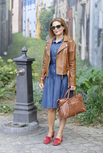 With denim knee length dress, brown leather jacket and brown leather bag