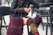 With denim mini skirt, black leather jacket and purple fringe bag