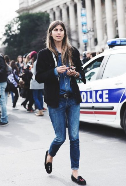 With denim shirt, jeans and black cardigan