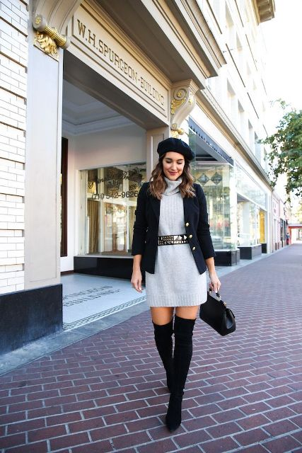 With embellished belt, black beret, black blazer, bag and suede boots