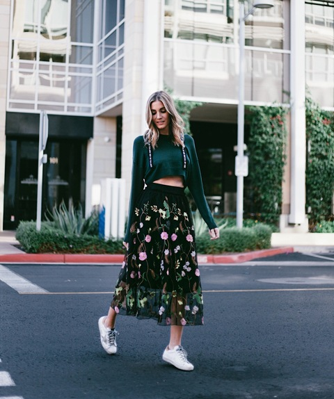With emerald crop sweater and white sneakers