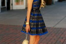 With golden mini bag and black patent leather pumps