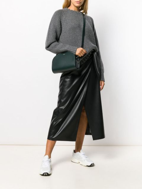 With gray loose sweater, white sneakers and black leather wrapped midi skirt