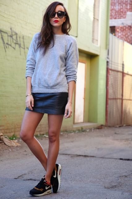 With gray sweatshirt and black shoes