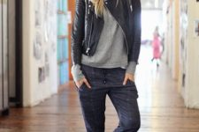 With gray sweatshirt, black leather jacket and white and black sneakers