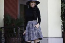 With gray wide brim hat, black shirt and black over the knee boots
