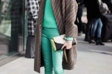 With green sweater, printed coat, green cropped pants and clutch