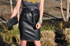 With labeled t-shirt, black leather clutch and cutout shoes