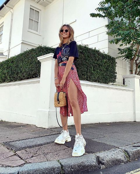 With labeled t-shirt, straw bag and white sneakers