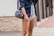 With lace top, navy blue blazer, black bag and white sneakers