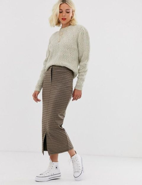 With light gray sweater and white sneakers