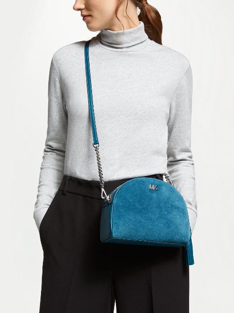 With light gray turtleneck and black loose pants
