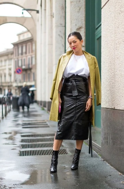 With loose blouse, coat and black high heeled boots