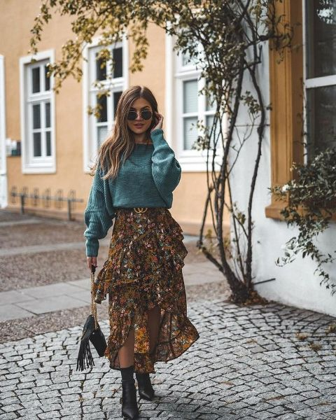 With loose sweater, black ankle boots and fringe bag