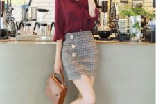 With marsala button down shirt, patent leather shoes and brown bag