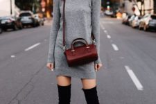 With marsala crossbody bag, sunglasses and black over the knee boots
