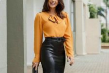 With orange blouse and black clutch