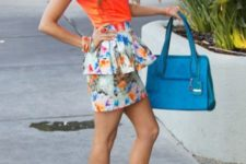 With orange shirt, blue bag and orange high heels