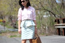 With pale pink button down shirt, brown tote bag and white pumps
