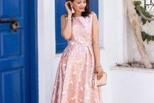 With pastel colored clutch and flat sandals