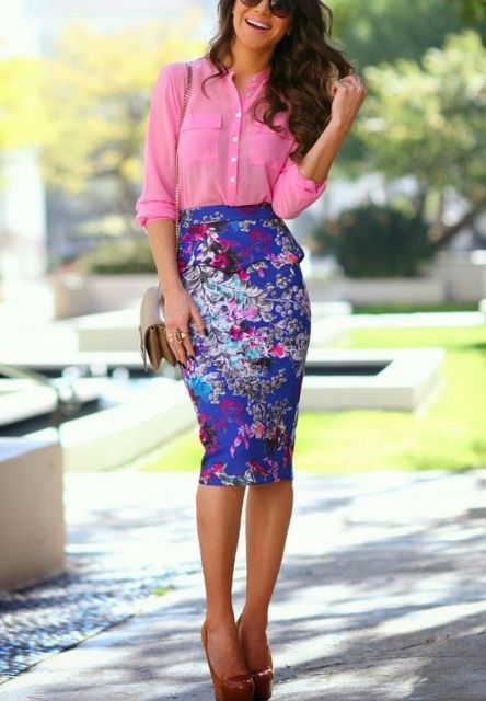 With pink shirt, patent leather high heels and bag