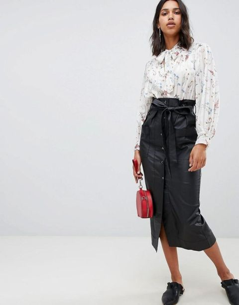 With printed blouse, red bag and flat mules