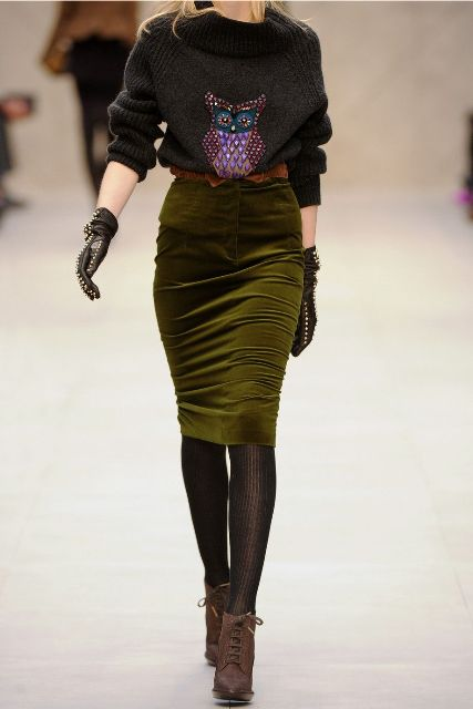 With printed sweater, black embellished gloves, black tights and brown lace up boots