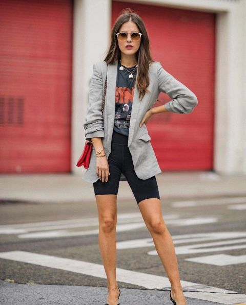 With printed t-shirt, gray blazer, black high heels and red bag