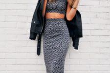 With printed top, black jacket and high heels