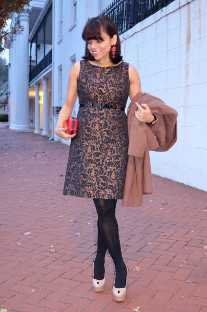 With red clutch, black tights, beige platform shoes and coat
