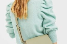 With skinny jeans and mint green sweater