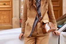 With striped button down shirt and brown suit