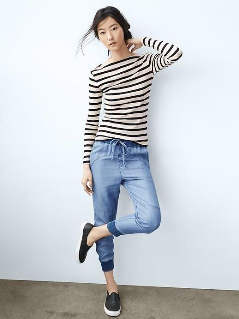 With striped shirt and black and white flat shoes