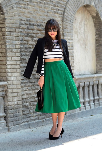 With striped shirt, black blazer, clutch and black pumps