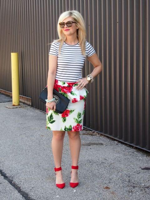 With striped shirt, black embellished clutch and red ankle strap shoes