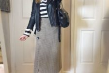 With striped shirt, black leather jacket, black and white sneakers and black leather bag