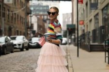 With striped sweater, pale pink bag and white and green sneakers