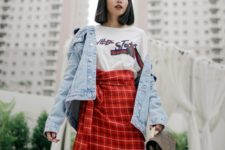 With t-shirt, denim jacket and printed bag