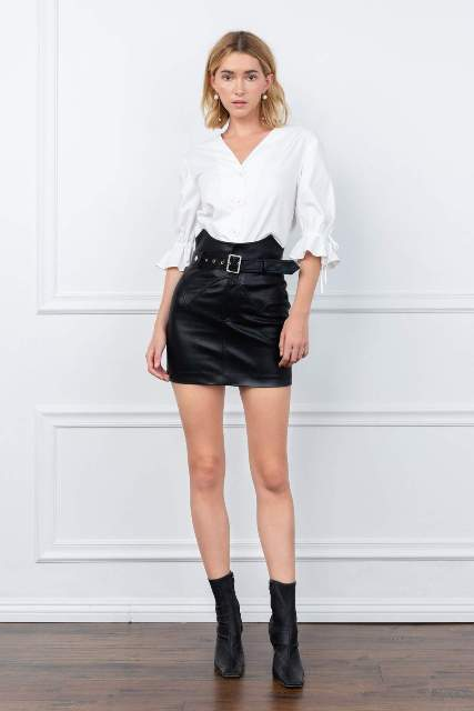 With white blouse and black mid calf boots